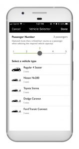 Cell phone open to the Accessible Dispatch mobile app. The screen shows the app open to where passengers enter the number of passengers and preferred vehicle type.