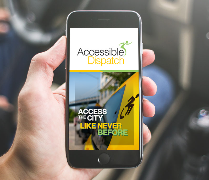 Hand holding a cell phone open to the Accessible Dispatch mobile app. The screen shows the Accessible Dispatch logo with 'Access the City like never before' on the backdrop of a yellow taxi.