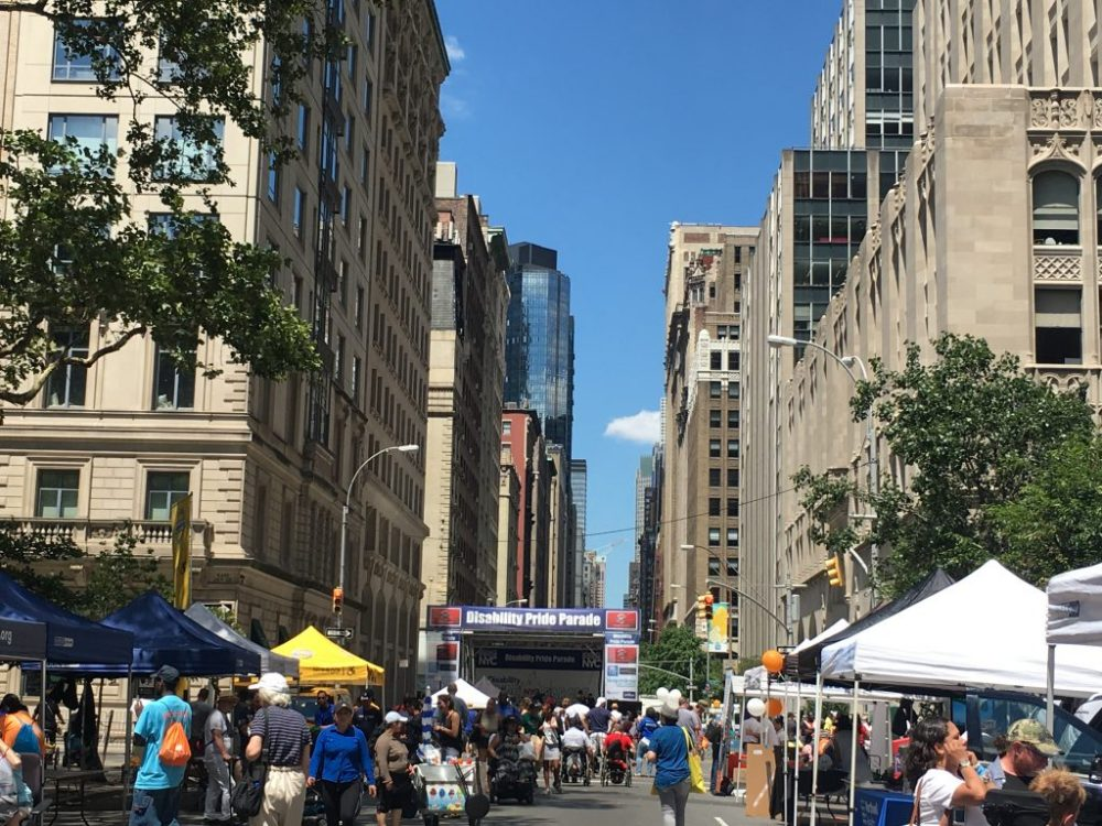 Scenic photo of last year's Disability Pride Parade displaying vendors and people engaging in the festival.