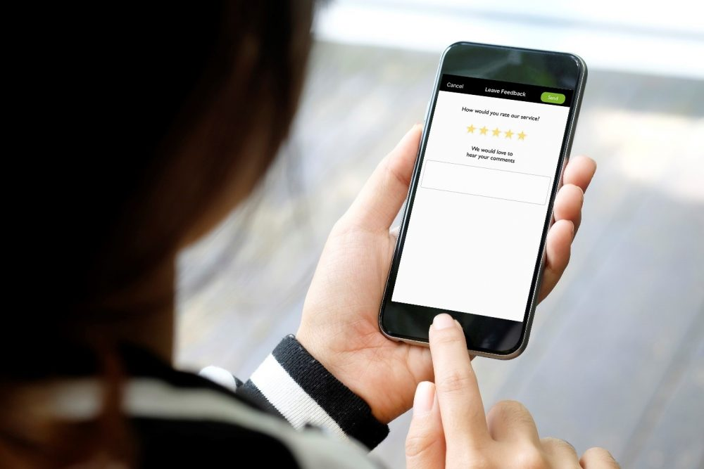 Photo of a passenger using the Accessible Dispatch NYC app's driver rating system.